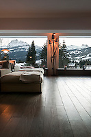 Stunning views of the mountains are offered from a pair of large picture windows in the living area