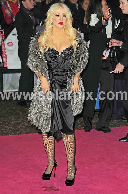 **ALL ROUND PICTURES FROM SOLARPIX.COM**                                             **WORLDWIDE SYNDICATION RIGHTS**                                                                                  Caption: arrives at the Gala Premiere of Burlesque at the Empire Cinema in London, UK. 13 December 2010                                                                              This pic: Christina Aguilera                                                                                        JOB REF: 12603 MSR       DATE: 13_12_2010                                                           **MUST CREDIT SOLARPIX.COM OR DOUBLE FEE WILL BE CHARGED**                                                                      **MUST AGREE FEE BEFORE ONLINE USAGE**                               **CALL US ON: +34 952 811 768 or LOW RATE FROM UK 0844 617 7637**