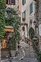 Rustic stone steps and shops in the medieval village of St Paul de Vance, Provence, France