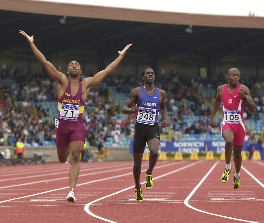 Photo. Richard Lane. .Norwich Union Olympic Trials and AAA Championships, Alexander Stadium , Birmingham. 13/8/2000.Darren Campbell crosses the line ahead of Christian Malcolm for victory in the Mens 200 Metres.