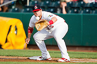 Matt Adams (25) of the Springfield Cardinals catches a ball thrown to first during a game against the Northwest Arkansas Naturals at Hammons Field on July 31, 2011 in Springfield, Missouri. Northwest Arkansas defeated Springfield 9-1. (David Welker / Four Seam Images)