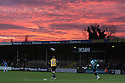 James Bittner of Salisbury City clears the ball beneath a dramatic sunset  during the Blue Square Premier match between Cambridge United and Salisbury City at the Trade Recruitment Stadium, Cambridge on 20th December, 2008. ©  Kevin Coleman