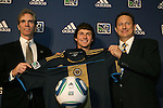 14 January 2010: Jack McInerney was selected with the #7 overall pick by the Philadelphia Union. From left: Jay Sugarman, Jack McInerney, Nick Sakiewicz. The 2010 MLS SuperDraft was held in the Ballroom at Pennsylvania Convention Center in Philadelphia, PA during the NSCAA Annual Convention.