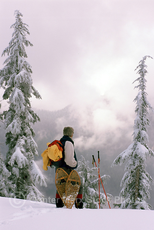 Woman snowshoeing in Mount Seymour Provincial Park, in the Coast Mountains, North Vancouver, British Columbia, Canada (Model Released)
