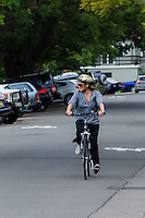 Georgie Parker riding her bicycle in Balmain