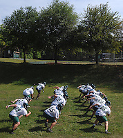 Jacksonville University offensive linemen mimic each other as they run a drill on a part of the practice field known as the pit on campus in Jacksonville, Fl. (The Florida Times-Union, Rick Wilson)