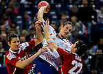 BELGRADE, SERBIA - DECEMBER 16:  Andrea Lekic (C) of Serbia is challenged by Bernadett Bodi (R) and Klara Szekeres (L) of Hungary during the Women's European Handball Championship 2012 third place match between Hungary and Serbia at Arena Hall on December 16, 2012 in Belgrade, Serbia. (Photo by Srdjan Stevanovic/Getty Images)