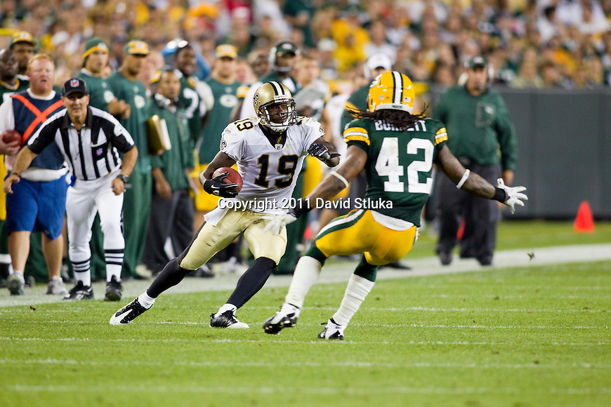 New Orleans Saints wide receiver Devery Henderson (19) carries the ball during a Week 1 NFL football game against the Green Bay Packers on September 9, 2011 in Green Bay, Wisconsin. The Packers won 42-34. (AP Photo/David Stluka)