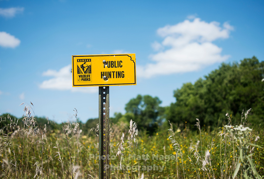 A sign marking a field open for hunting during opening day of the dove hunting season on Kansas State Wildlife fields near Wamego, Kansas, Sunday, September 1, 2013. Opening day is known for being a festive day of hunting with family and friends. <br /> <br /> Photo by Matt Nager