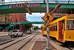 The tram stop in Ybor City, Florida. Ybor City is not far from downtown Tampa, and was founded in the late 1800's by cigar manufactures and was mainly dominated by cigar factories for 50 years. Ybor City is now a National Historic Landmark District. The trams that run between Tampa and Ybor City are heritage line cars that started in 2002, based on the first electrical trams in Tampa in 1892.