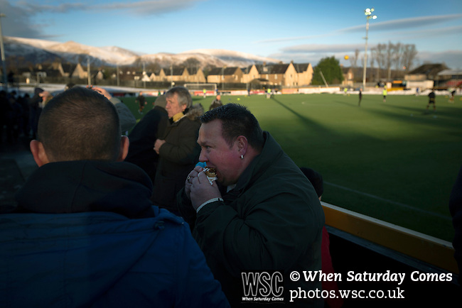 Alloa Athletic 0 Peterhead 1,14/01/2017. Recreation Park, Scottish League One. A home fan eating a pie at Recreation Park before Alloa Athletic played Peterhead in a Scottish League One fixture. The club was formed in 1878 as Clackmannan County, changing the name to Alloa Athletic in 1883. The visitors won the match by one goal to nil, watched by a crowd of 504. Photo by Colin McPherson.