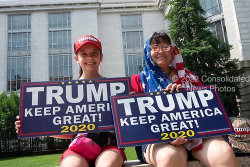 Alison and Amy Minzola, of Hazelton, Pennsylvania, await  the Independence Day Parade along Constitution Avenue in Washington DC on July 4, 2019.<br /> <br /> Credit: Stefani Reynolds / CNP