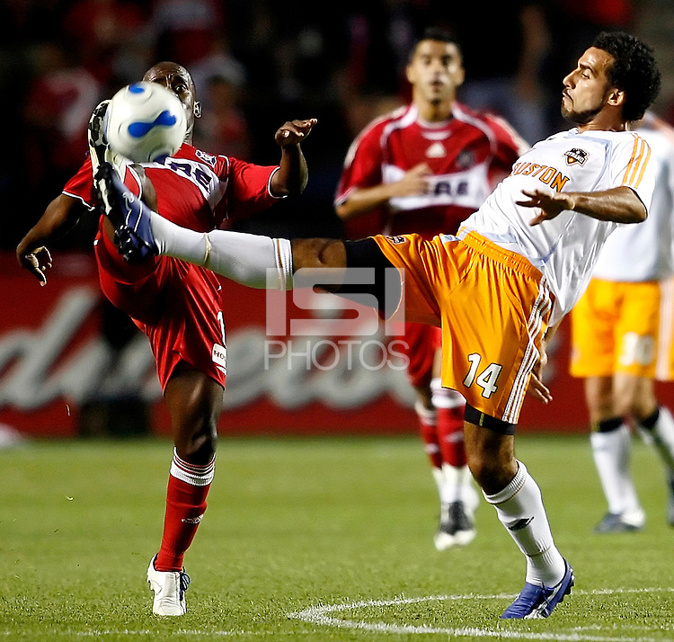 Chicago Fire midfielder Thiago (11) and Houston Dynamo midfielder Dwayne De Rosario (14) battle for the ball.  The Houston Dynamo defeated the Chicago Fire 4-0 at Toyota Park in Bridgeview, IL on July 12, 2007.