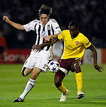 Partizan player Cleo, left, fight for the ball against Arsenal player Johan Djourou,  during  UEFA Champions league match in group H FC Partizan Belgrade Vs. Arsenal, London, Serbia, Monday, Sept. 28, 2010.  (Srdjan Stevanovic/Starsportphoto.com)
