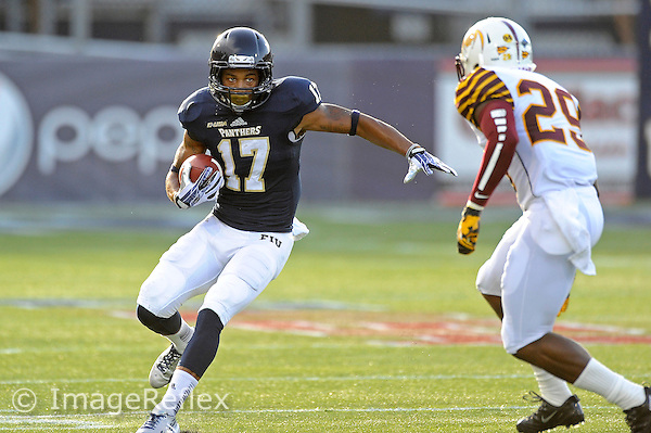 14 September 2013:  FIU wide receiver T.J. Lowder (17) evades Bethune-Cookman defensive back Dion Hanks (29) after a reception in the first quarter as the Bethune-Cookman Wildcats defeated the FIU Golden Panthers, 34-13, at FIU Stadium in Miami, Florida.