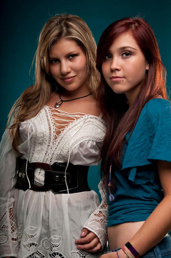 Young caucasian girls enjoying friendship and having fun.