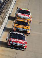 Sept. 21, 2008; Dover, DE, USA; Nascar Sprint Cup Series driver Carl Edwards leads teammates Matt Kenseth and Greg Biffle during the Camping World RV 400 at Dover International Speedway. Mandatory Credit: Mark J. Rebilas-