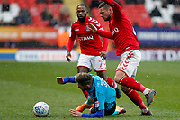 Wes Burns of Fleetwood Town is felled by Jake Forster-Caskey of Charlton FC during the Sky Bet League 1 match between Charlton Athletic and Fleetwood Town at The Valley, London, England on 17 March 2018. Photo by Carlton Myrie.