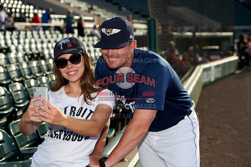 Lakeland Flying Tigers manager Andrew Graham (17) takes a selfie with a fan before a game against the Jupiter Hammerheads on April 17, 2017 at Joker Marchant Stadium in Lakeland, Florida.  Lakeland defeated Jupiter 5-1.  (Mike Janes/Four Seam Images)