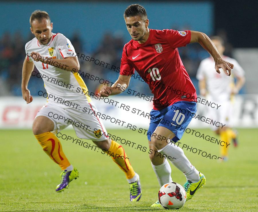 Fudbal Soccer<br /> World Cup 2014 qualifiers match<br /> Serbia v Macedonia<br /> Dusan Tadic (R) and Ostoja Stjepanovic (L)<br /> Jagodina, 15.10.2013.<br /> foto: Srdjan Stevanovic/Starsportphoto &copy;