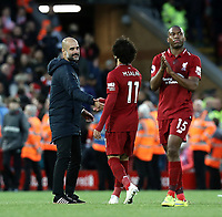 Manchester City manager Josep Guardiola greets Liverpool's Mohamed Salah at the final whistle<br /> <br /> Photographer Rich Linley/CameraSport<br /> <br /> The Premier League - Liverpool v Manchester City - Sunday 7th October 2018 - Anfield - Liverpool<br /> <br /> World Copyright &copy; 2018 CameraSport. All rights reserved. 43 Linden Ave. Countesthorpe. Leicester. England. LE8 5PG - Tel: +44 (0) 116 277 4147 - admin@camerasport.com - www.camerasport.com