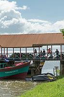 Group of people on a bridge across San Juan River and nearby boats, San Carlos, Rio San Juan Department, Nicaragua