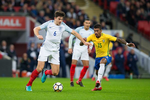 England's Harry Maguire holds off the challenge from Brazil&rsquo;s Paulinho <br /> <br /> Photographer Craig Mercer/CameraSport<br /> <br /> The Bobby Moore Fund International - England v Brazil - Tuesday 14th November 2017 Wembley Stadium - London  <br /> <br /> World Copyright &copy; 2017 CameraSport. All rights reserved. 43 Linden Ave. Countesthorpe. Leicester. England. LE8 5PG - Tel: +44 (0) 116 277 4147 - admin@camerasport.com - www.camerasport.com