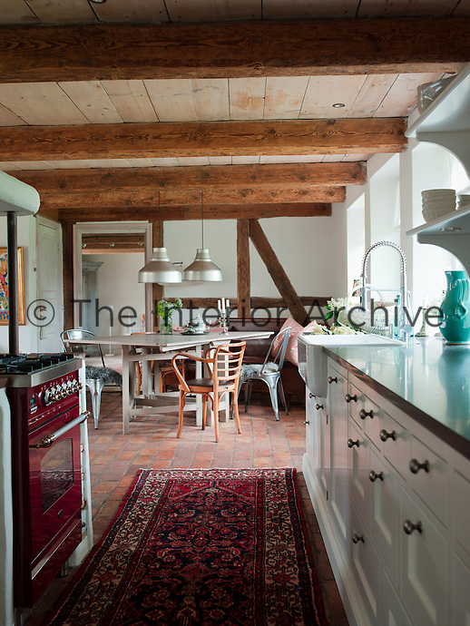 View from the work area of the kitchen into the dining section with its half timbered wall