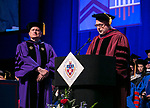 Helmut P. Epp, left, professor, former dean and former provost, receives a Via Sapientiae Award from David Miller, dean of the DePaul University College of Computing and Digital Media Sunday, June 11, 2017, during the DePaul University College of Computing and Digital Media and the College of Communication commencement ceremony at the Allstate Arena in Rosemont, IL. (DePaul University/Jamie Moncrief)