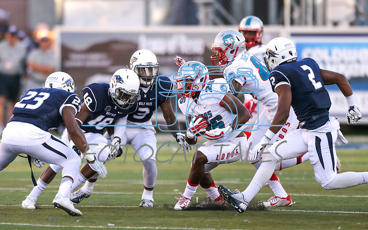 Nevada defenders, from left, Dameon Baber, Elijah Moody, Ahki Muhammad and Asauni Rufus pursue New Mexico running back Tyrone Owens during an NCAA college football game in Reno, Nev., on Saturday, Oct. 10, 2015. Nevada won 35-17. (AP Photo/Cathleen Allison)