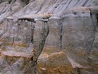 NDTR_119 - USA, North Dakota, Theodore Roosevelt National Park, Hard sandstone caprocks lie above softer clay sediments displaying rill erosion, Caprock-Coulee Area, North Unit.
