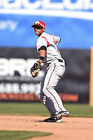 Carolina Mudcats shortstop Erik Gonzalez (10) throws to first during a game against the Frederick Keys on April 26, 2014 at Harry Grove Stadium in Frederick, Maryland.  Carolina defeated Frederick 4-2.  (Mike Janes/Four Seam Images)