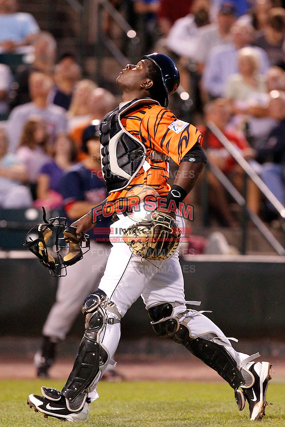 Rochester Red Wings catcher Jair Fernandez #48 chases down a foul ball during a game against the Pawtucket Red Sox at Frontier Field on August 30, 2011 in Rochester, New York.  Rochester defeated Pawtucket 8-6 as the team wore special jerseys to be auctioned off after the game to benefit the zoo.  (Mike Janes/Four Seam Images)