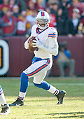 Buffalo Bills quarterback Tyrod Taylor (5) looks for a receiver in the first quarter against the Washington Redskins at FedEx Field in Landover, Maryland on Sunday, December 20, 2015.<br /> Credit: Ron Sachs / CNP