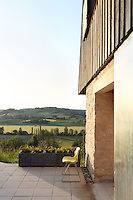 A tiled patio overlooking the Lendou Valley catches the last of the evening sunshine