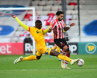 Lincoln City's Bruno Andrade vies for possession with Northampton Town's Hakeem Odoffin<br /> <br /> Photographer Andrew Vaughan/CameraSport<br /> <br /> Emirates FA Cup First Round - Lincoln City v Northampton Town - Saturday 10th November 2018 - Sincil Bank - Lincoln<br />  <br /> World Copyright © 2018 CameraSport. All rights reserved. 43 Linden Ave. Countesthorpe. Leicester. England. LE8 5PG - Tel: +44 (0) 116 277 4147 - admin@camerasport.com - www.camerasport.com