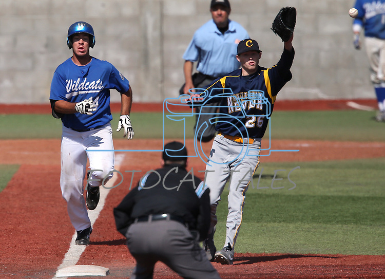 Western Nevada's Connor Klein races down the base line against Southern Nevada's Will Morris during a college baseball game in Carson City, Nev., on Friday, March 22, 2013. WNC won the first game 4-1..Photo by Cathleen Allison/Nevada Photo Source