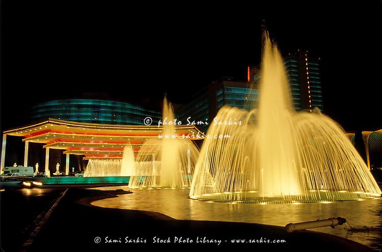 Water fountains outside Caesars Palace at night, Las Vegas, Nevada, USA.