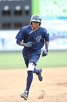 Erick Mejia (29) of the Everett AquaSox runs the bases during batting practice before a game against the Spokane Indians at Everett Memorial Stadium on July 25, 2015 in Everett, Washington. Spokane defeated Everett, 10-1. (Larry Goren/Four Seam Images)