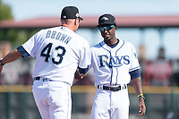 Peoria Javelinas shortstop Lucius Fox (5), of the Tampa Bay Rays organization, shakes hands with manager Daren Brown (43) during player introductions before the Arizona Fall League Championship game against the Salt River Rafters at Scottsdale Stadium on November 17, 2018 in Scottsdale, Arizona. Peoria defeated Salt River 3-2 in 10 innings. (Zachary Lucy/Four Seam Images)