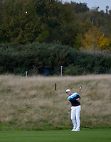 16.10.2014. The London Golf Club, Ash, England. The Volvo World Match Play Golf Championship.  Day 2 group stage matches.  Jamie Donaldson [WAL] approach shot on the seventh.