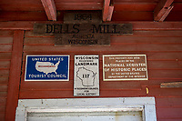 The Dells Mill<br /> <br /> Water-Powered grist mills ground the wheat that dominated Wisconsin's Civil War-era economy. Built in 1864, the mill was one of the server serving area farmers. After wheat production moved westward, owners adapted the building to mill flour and grind feed.<br /> <br /> A trip to the Dells mill could be an all-day family affair. Farmers often fished the millpond to pass the time. The millpond also provided a source for the winter ice harvest. A store, hotel, and school grew up nearby to serve the growing community<br /> <br /> Creating a mill pond required the building of a dam to flood upstream land. The Wisconsin Territorial Legislature enacted legislation enabling dam construction in 1840.<br /> <br /> Built along the dells of Bridge Creek, the base of the mill was carved into the sandstone bedrock. massive hand-hewn timbers secured with wooden pegs make up the structure of the Mill. Water turbines powered the milling process. A concrete dam replaced the original log structure in 1919. Dells Mill, which is listed on the National Register of Historic Places, operated continuously until 1968
