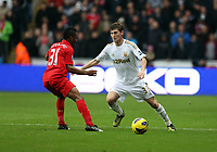 Sunday, 25 November 2012<br /> Pictured: Ben Davies of Swansea (R) against Raheem Sterling of Liverpool (L)<br /> Re: Barclays Premier League, Swansea City FC v Liverpool at the Liberty Stadium, south Wales.