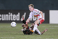 New York Red Bulls midfielder Dax McCarty goes against D.C. United midfielder Marcelo Saragosa (11) The New York Red Bulls tied D.C. United 2-2 at RFK Stadium, Wednesday August 29, 2012.