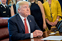 United States President Donald Trump pauses after speaking while meeting with the crew and passengers of Southwest Airlines Co. flight 1380 in the Oval Office of the White House in Washington, D.C., U.S., on Tuesday, May 1, 2018. An engine on Southwest's flight 1380, a Boeing Co. 737-700 bound for Dallas from New York's LaGuardia airport, exploded and made an emergency landing on April 17 sending shrapnel into the plane and killing a passenger seated near a window. <br /> Credit: Andrew Harrer / Pool via CNP /MediaPunch