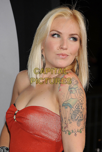 "Cherish Lee.arriving at the Los Angeles Premiere of ""Final Destination 5"" at Grauman's Chinese Theatre in Hollywood, California, USA, August 10th, 2011..portrait headshot red strapless  tattoos .CAP/ROT/TM.©TM/Roth Stock/Capital Pictures"