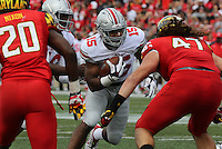 Ohio State Buckeyes running back Ezekiel Elliott (15) breaks through the Maryland Terrapin offense in the third quarter of their game at Byrd Stadium in College Park, Maryland on October 4, 2014. (Columbus Dispatch photo by Brooke LaValley)
