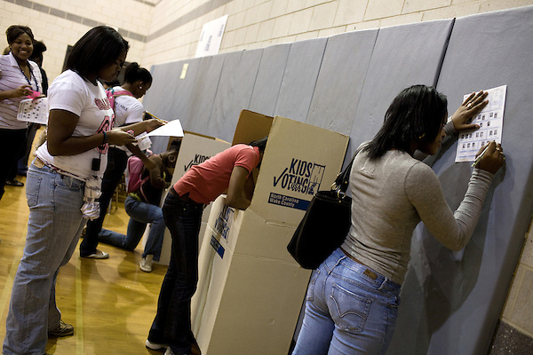 November 4, 2008. Raleigh, NC.. As voters hit the polls in the heavily contested state of North Carolina, turnout was high, even given the rainy weather throughout the state.. Students at Southeast Raleigh Magnet High School participated in the Kids Voting USA project, that allowed underage students to cast ballots in the national and local elections in their district.