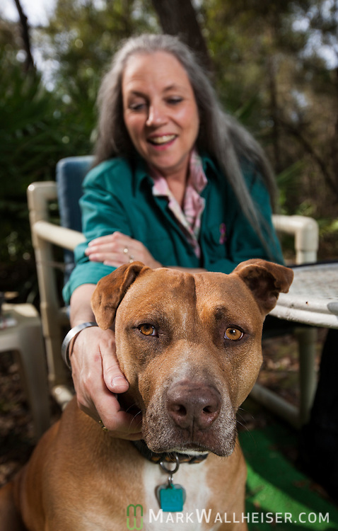 Krista Campbell and her dog Diesel, enjoy the outdoors in their back yard in Old Town, Florida January 22, 2013.