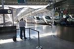Trains at platform inside María Zambrano railway station Malaga, Spain